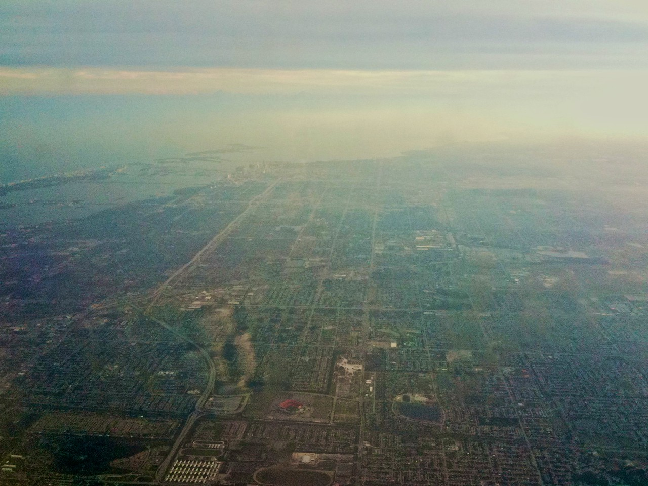 View over the Miami area taken with my iPhone as I flew to New Orleans. You can just make out the tall buildings of downtown Miami in the middle distance of the photo, as well as barrier islands which make up the city of Miami Beach on the left-hand side, separating the mainland and Biscayne Bay from the Atlantic Ocean.