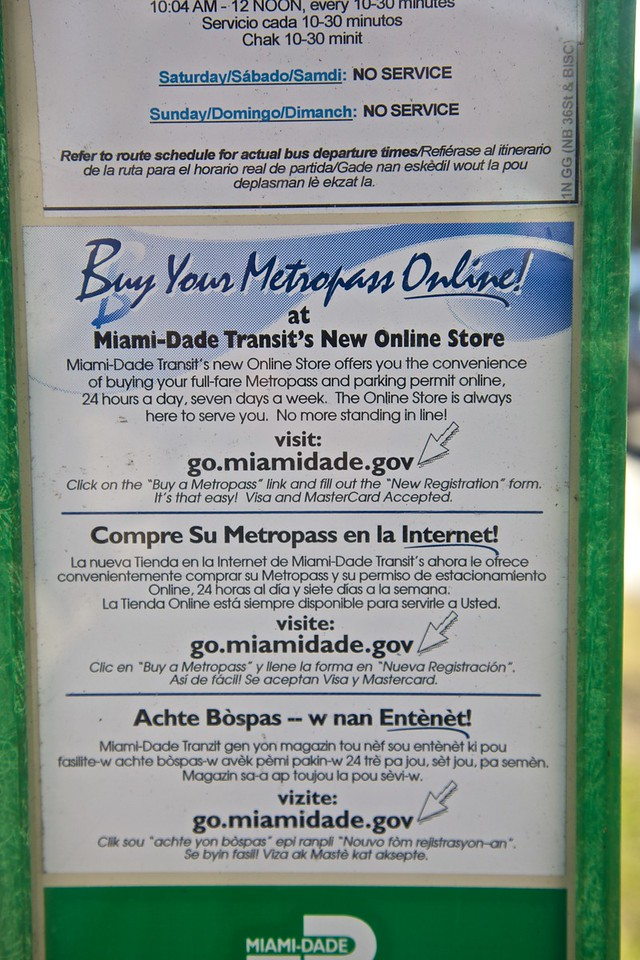 A notice at a bus stop in Miami in English, Spanish, and Haitian Creole (a French creole).