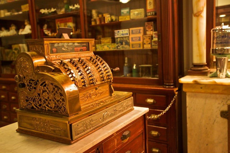 An ornately carved cash register in the replica drugstore/milk-bar in the North Carolina Museum of History, Raleigh.