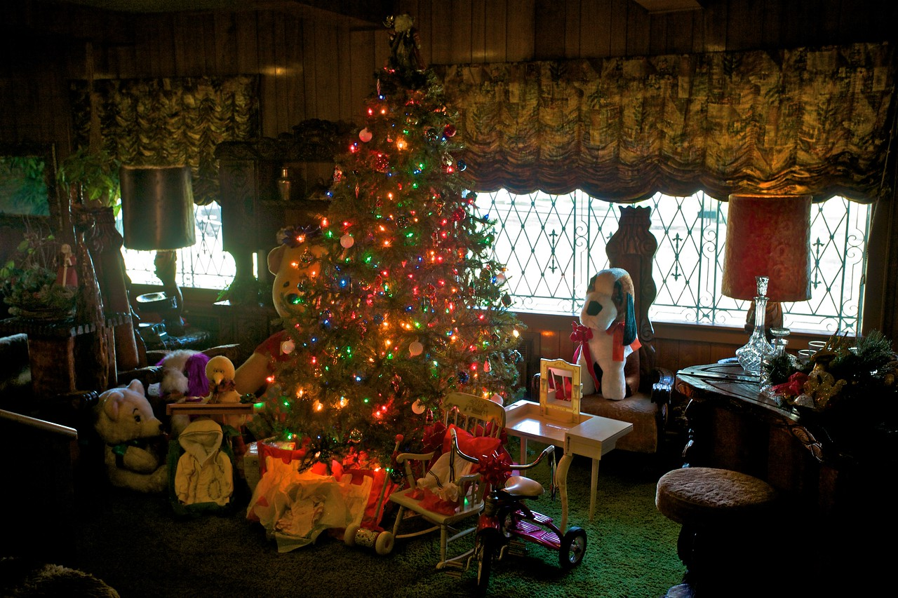 Christmas tree number three, with presents piled around it, in the 'Jungle Room' in Graceland.