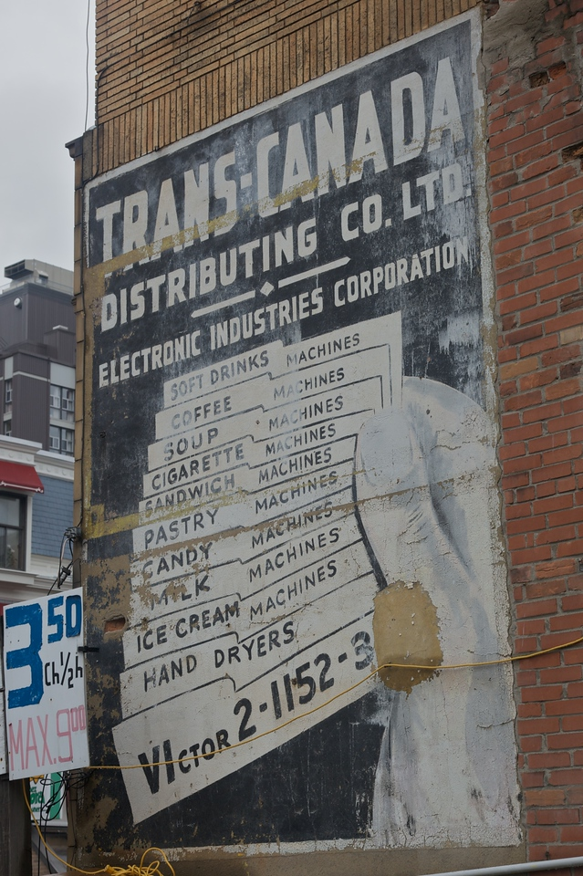 Another wall-painted sign which has lasted the tests of time. All those machines!