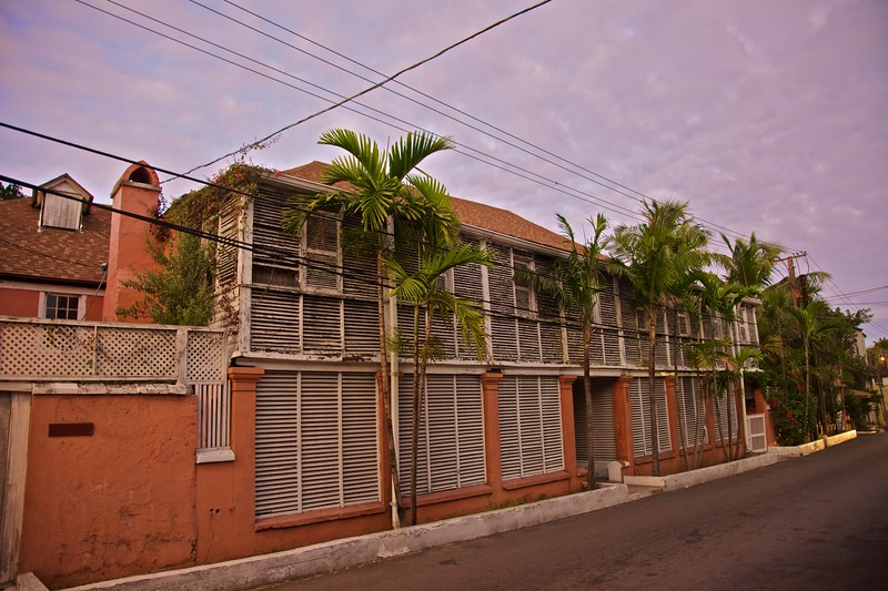 A residential street in Nassau after sunset.