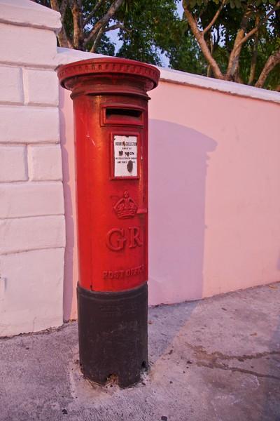A red pillar-box in Nassau at dusk.