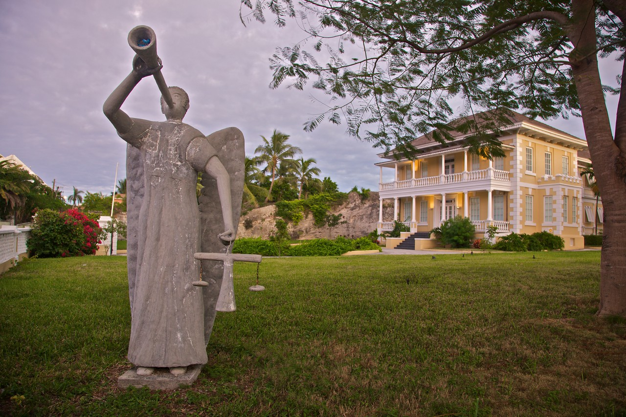 A statue outside the Bahamian National Art Gallery in Nassau after sunset.