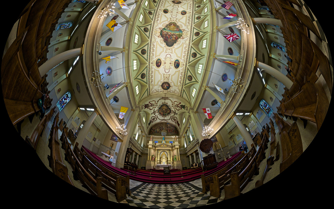 Inside the cathedral of King St Louis which is the centrepiece of the French Quarter in New Orleans. This photo is built from 33 photos stitched together and manipulated to look as if it had been shot with a fisheye lens.