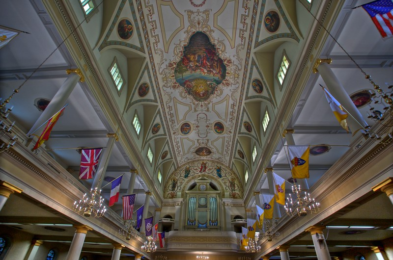 Flags, ceiling, and organ in St Louis' Cathedral in New Orleans.