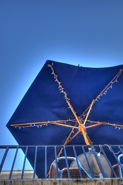 An umbrella on a rooftop bar.