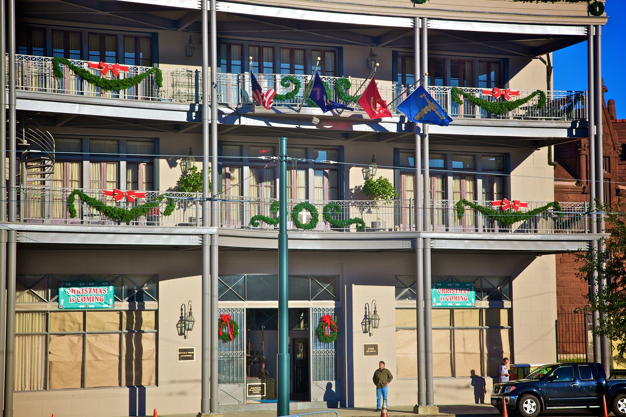 A building in New Orleans on 25th November 2009 with Christmas decorations and posters proclaiming 'Christmas is coming'.