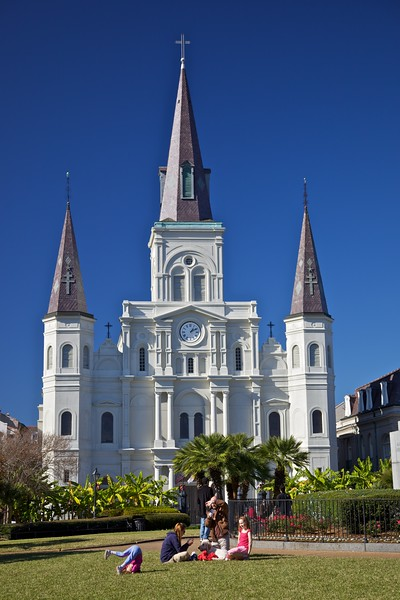 A family in the park opposite St Louis' cathedral in New Orleans.