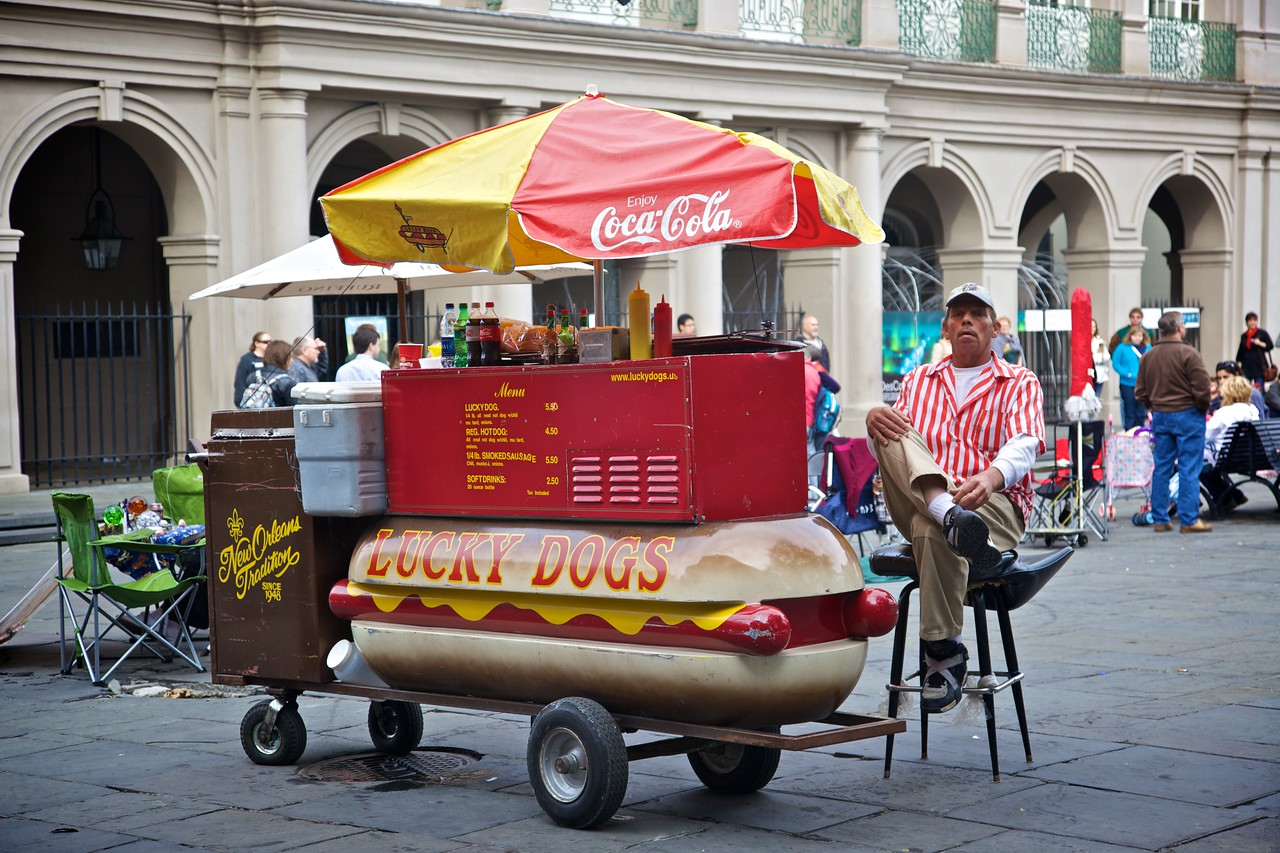 "A man selling hot-dogs from a cart in Jackson Square in New Orleans. He gives no impression of otherwise being like the character Ignatius J. Reilly in <a href=""http://en.wikipedia.org/wiki/A_Confederacy_of_Dunces"" title=""A Confederacy of Dunces - Wikipedia, the free encyclopedia""><cite>A Confederacy of Dunces</cite></a>."