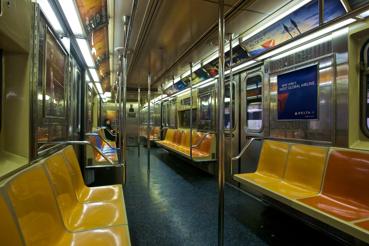 Inside an almost-empty Downtown 1 Train.