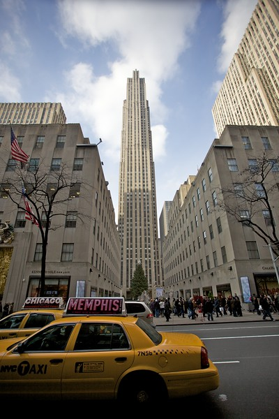 Taxis pass the GE Building (30 Rockefeller Center) in 5th Avenue.
