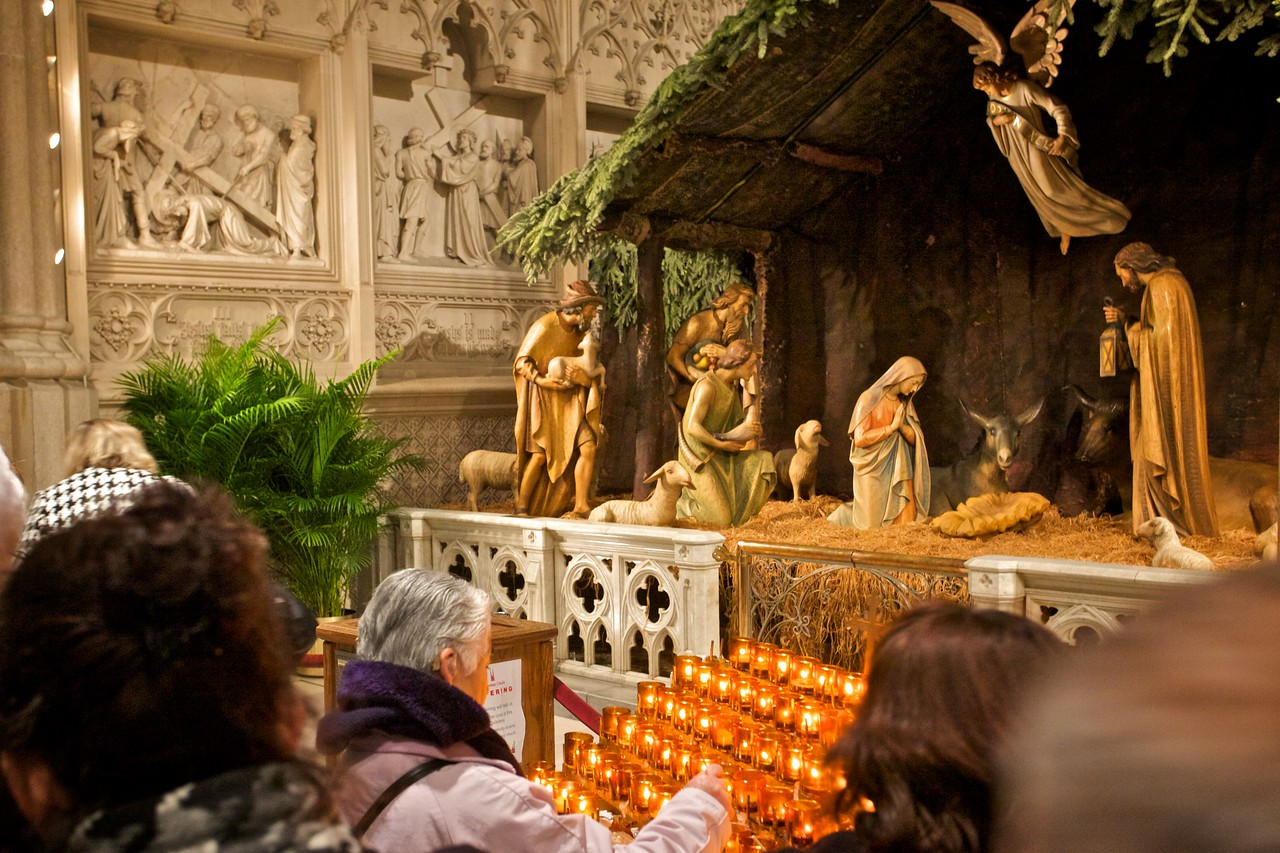 Some of the faithful in front of the nativity scene in St Patrick's Cathedral on 14th December 2009. Because of the date, the manger still lies empty.