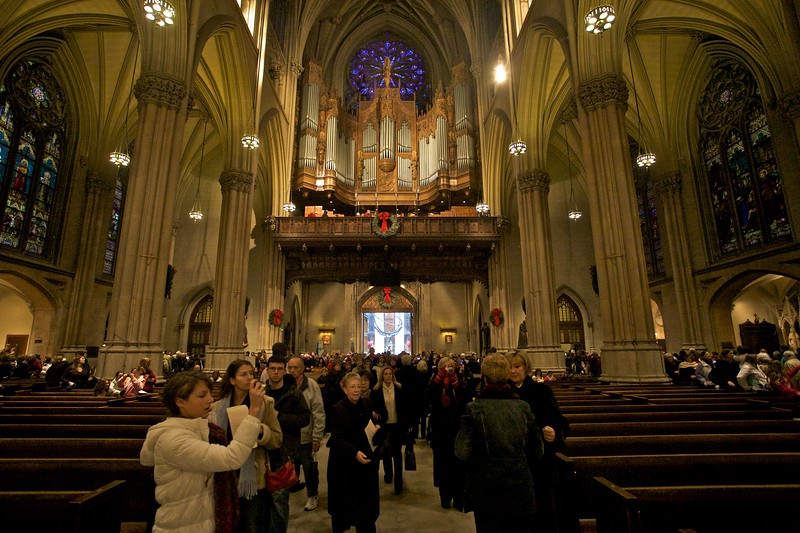 "Inside St Patrick's Cathedral, New York. Looking towards the organ over the west door onto 5th Avenue. Through the door you can see the <a href=""http://richardflynn.smugmug.com/2009/North-America-Travel-2009/New-York-around-the-city/10312761_aFhNA#712767049_TYtiX"" title=""New York: around the city, October 2009 - Photos † Richard Flynn "">statue of Atlas which stands outside the G.E. Building</a>."