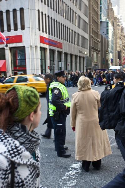 A cop provides assistance ofr a pedestrian.