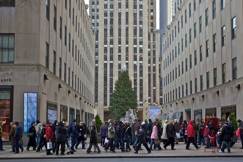 Crowds file past the famous Christmas tree in Rockefeller Center on 14th December 2009.