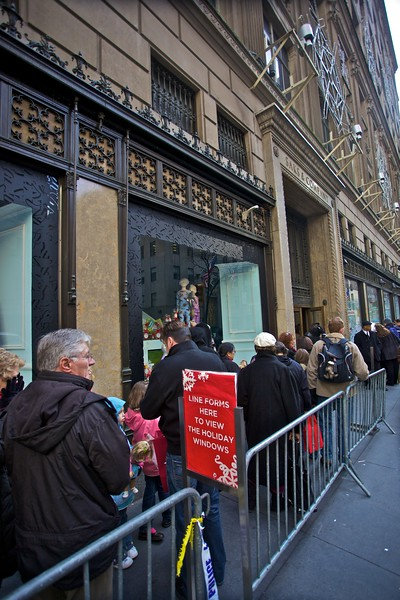 People queue up to see the Christmas window-displays in the Saks department store in 5th Avenue.