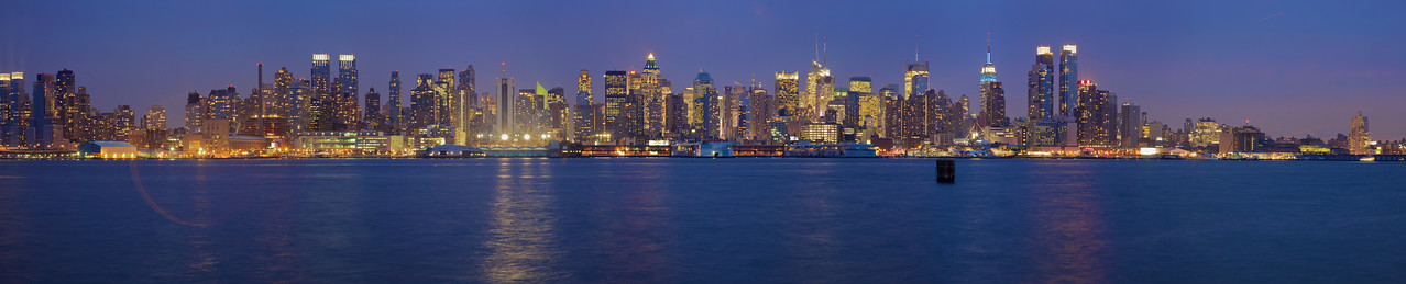 A panorama view of Midtown Manhattan, as seen from Weehawken at dusk. (Five photos stitched together.)