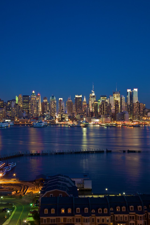The lights of Manhattan at Dusk, looking across the Hudson River from Weehawken.