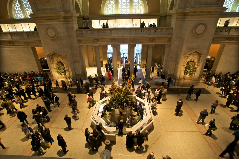 Gallery visitors pass to and fro in the entrance hall of the Metropolitan Museum of Art.