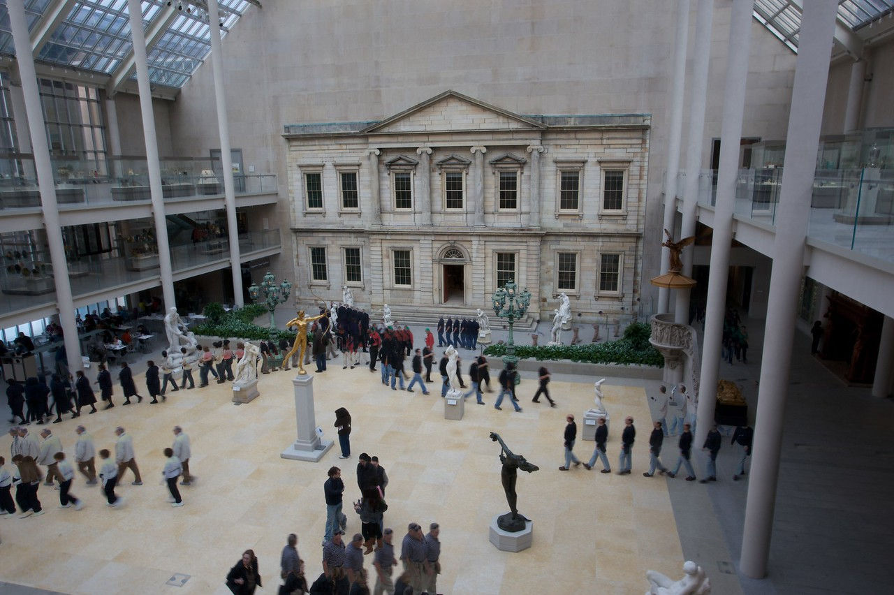 People pass through the American Wing courtyard. (Met.)<br /> <br /> (Seven photos blended together.)