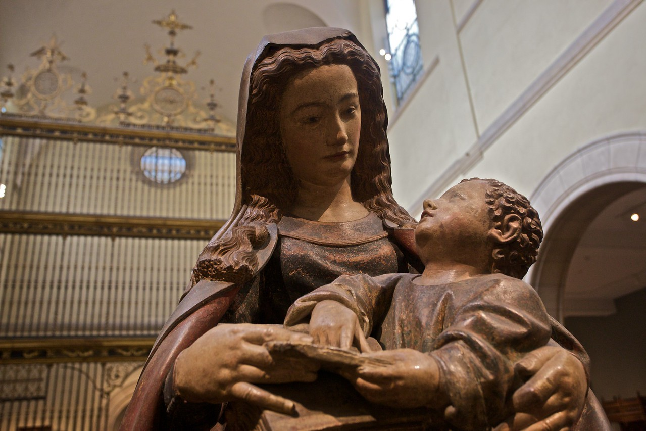 Medieval statue of the Virgin and child in front of the rood screen from the cathedral at Valladolid. (Met.)