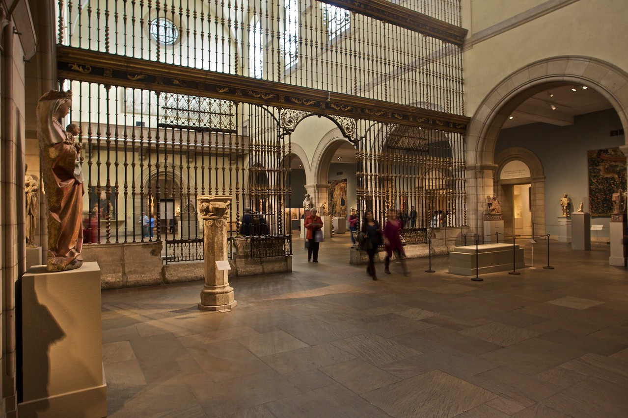Visitors in the medieval gallery pass through the rood screen from Valladolid cathedral. (Met.)