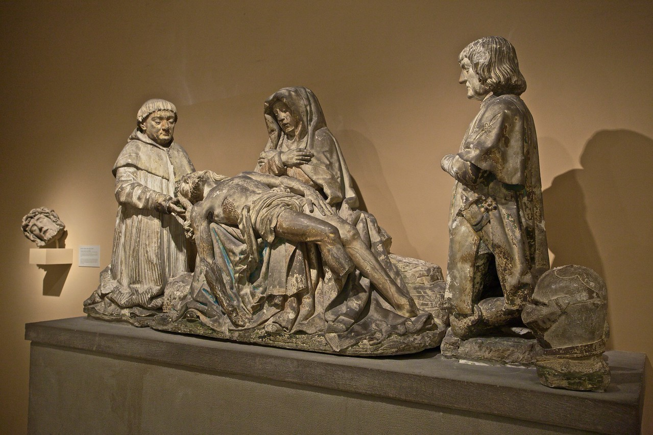 Pietà with donors (French, c. 1515): the donors are Pons de Gontaut and his brother Armand, Bishop of Sarlat, in whose family funerary chapel this sculpture originally stood. (Met.)