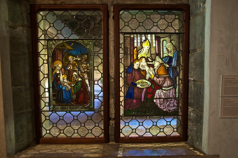Two stained-glass windows: the adoration of the Magi (1507) by the Circle of the Strassburger Werkstattgemeinschaft (active in southern and central Germany c. 1470–1500), and the circumciscion (c. 1460–70) by the Kreussbrüder (Cologne). (Cloisters)