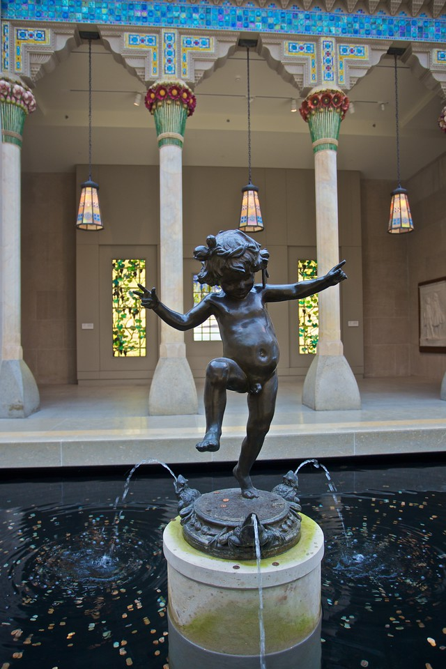 A dancing cupid in the American Wing courtyard. (Met.)