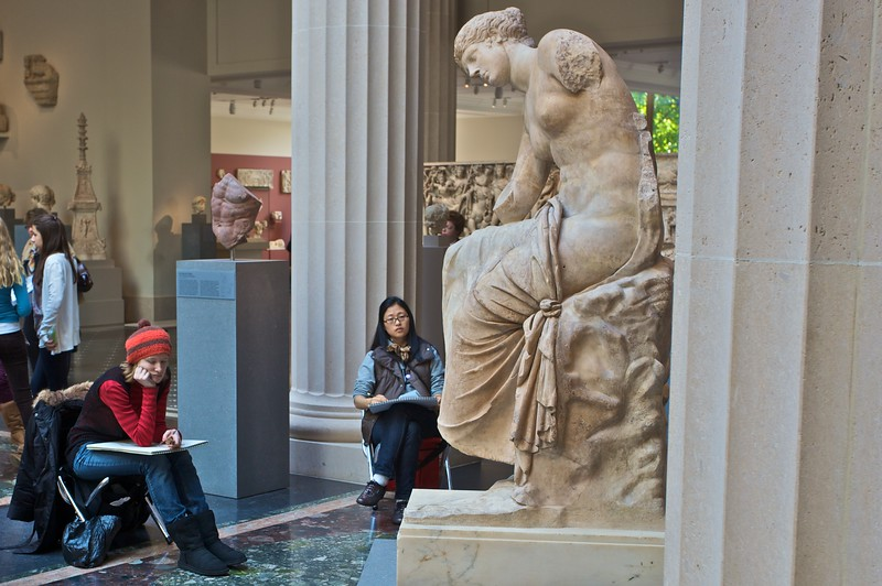 A group sketches a Roman statue. (Met.)