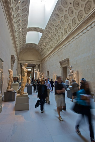 Visitors pass through one of the Classical galleries in the Met. (Met.)