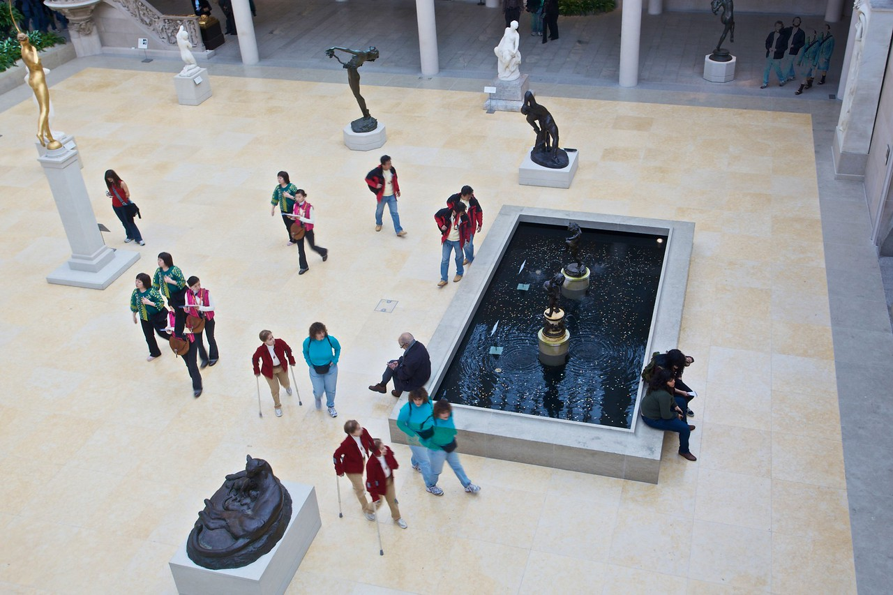 People pass through the American Wing courtyard. (Met.)<br /> <br /> (Three photos blended together.)