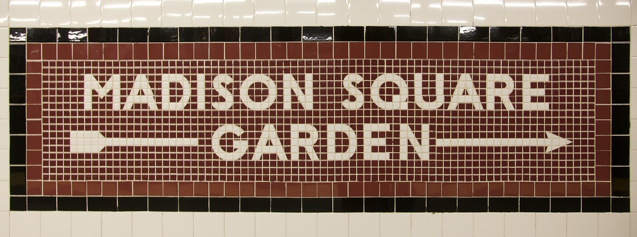 "A mosaic direction-sign in 34th Street/Penn. Station subway station. Many signs of this kind have been preserved all over the New York City Subway system; there is a fascinating article on the AIGA site called <a href=""http://www.aiga.org/content.cfm/the-mostly-true-story-of-helvetica-and-the-new-york-city-subway"" title=""The (Mostly) True Story of Helvetica and the New York City Subway — AIGA 