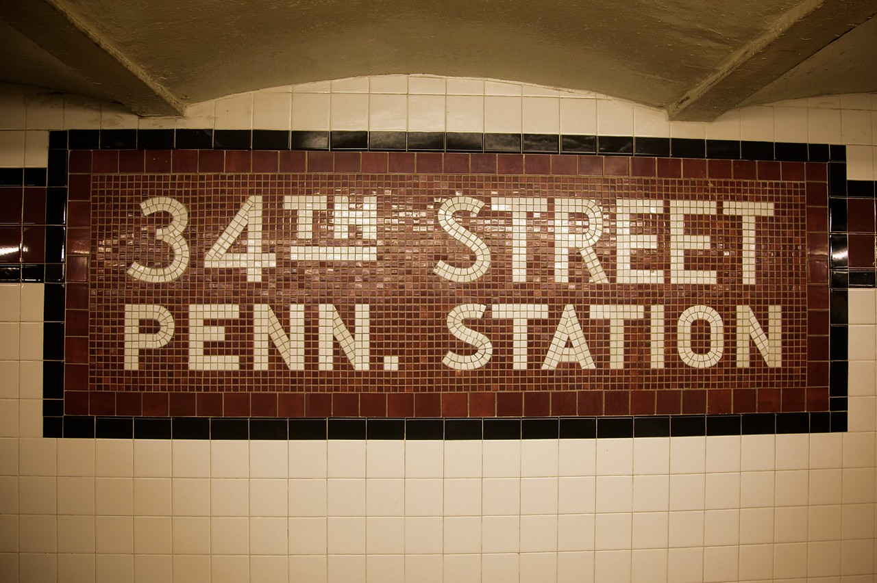Another mosaic subway station sign.