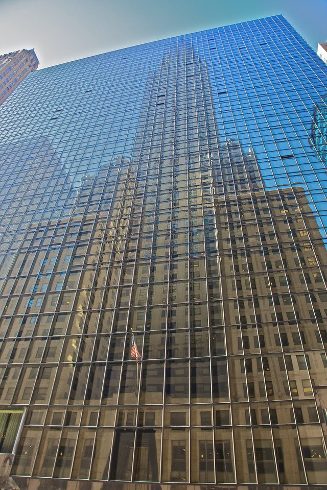 The Chrysler building reflected in the Hyatt hotel adjacent.