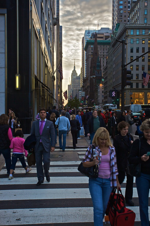 Pedestrians in 5th Avenue. The Empire State Building is in the distance.