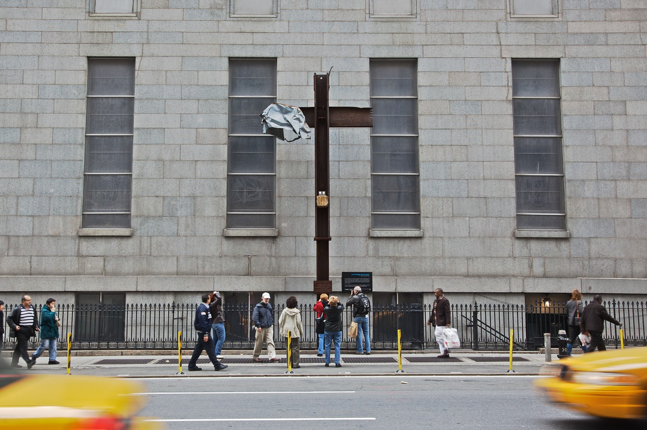 People photograph the World Trade Center cross.