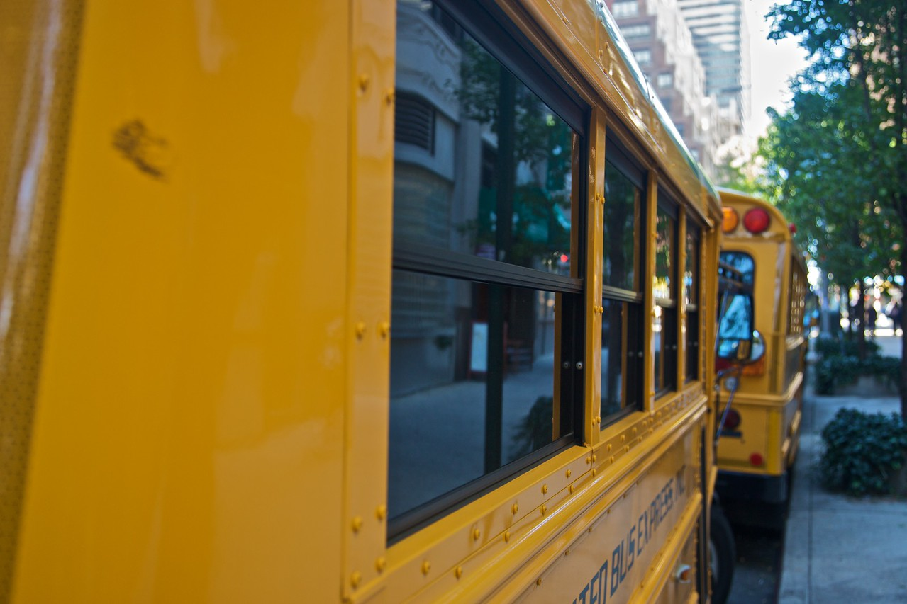 School buses parked along 45th Street in Manhattan.