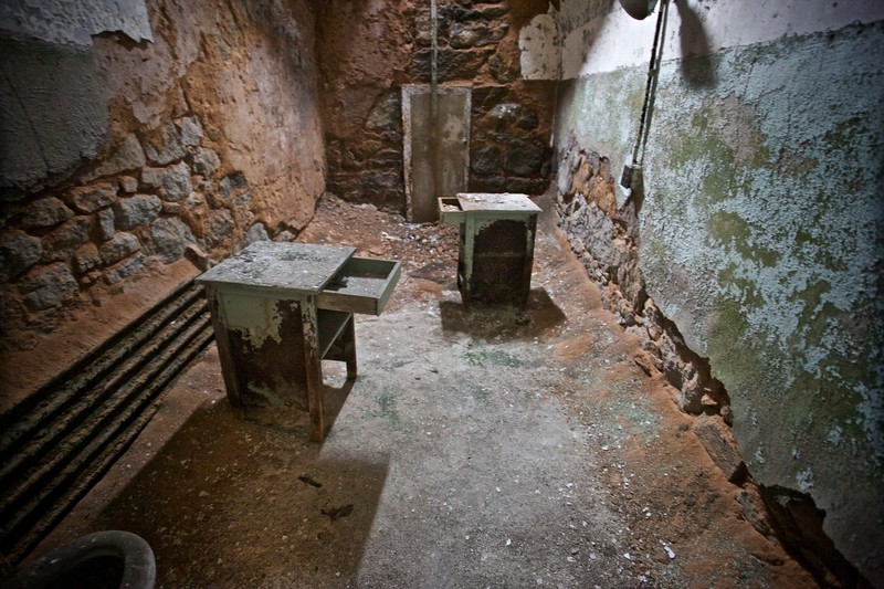 A dilapidated cell in the East State Penitentiary.