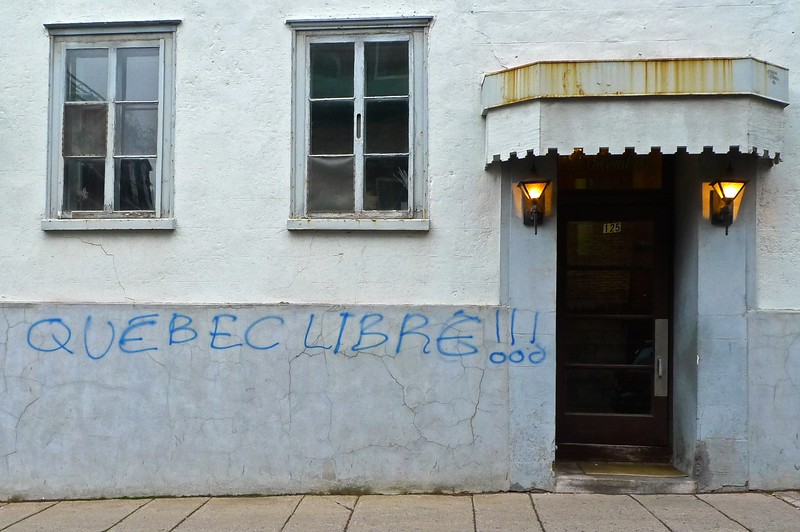 'Québec libre' graffiti on a building in Quebec (the city). You'll notice that the tagger has included the acute accent on the first 'E', which is strictly unnecessary on capital letters. This is the only significant indication of a desire for an independent Quebec which I saw during my week in the province.<br /> <br /> (First in my unplanned series of the doors and windows of Quebec.)