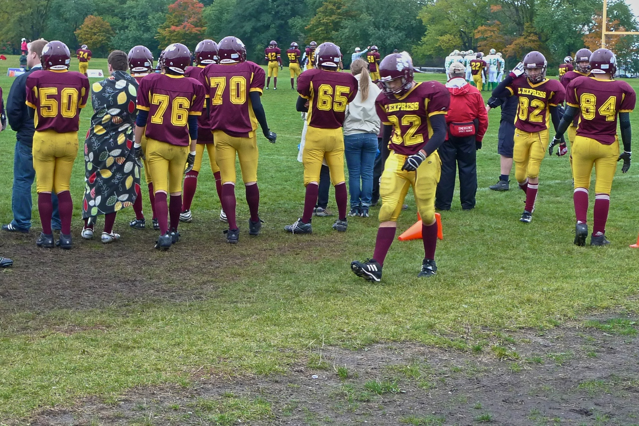 American football players from a local team along the sideline in their match against an Irish school ('ethnically' Irish, from elsewhere in Canada) at the southern end of the Plains of Abraham.