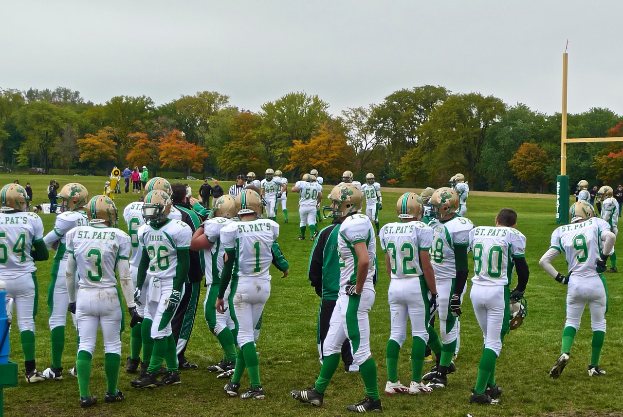 Members of the St Pat's American football team playing a Sunday-afternoon match against a Quebec school side.