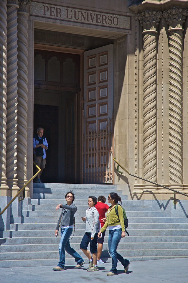 Tourists walk past the Italian-built church of Sts Peter and Paul in San Francisco.