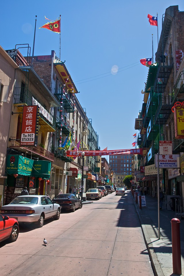 A street in Chinatown in San Francisco. Notice the Taiwanese flags on the building on the right.