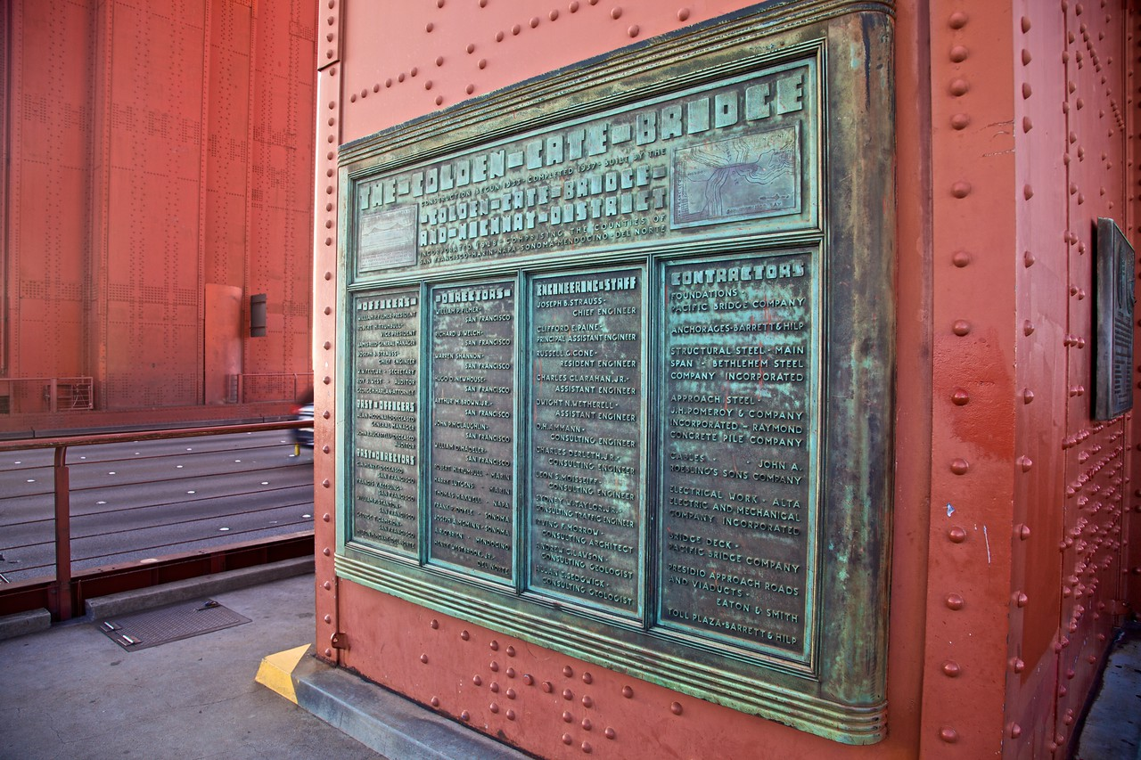 This plaque on the south-east pylon of the Golden Gate Bridge commemorates many of those involved with the bridge's construction. (Zoom to the largest size in order to be able to read the inscriptions.)