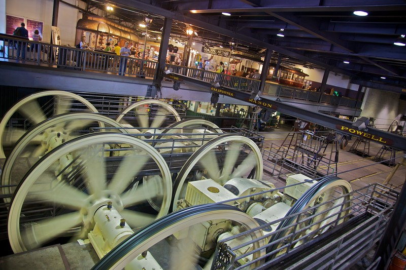 The motors of the San Francisco cable car system can be seen in the cable car museum. Each cable here controls one of the four lines which are now in operation. The cables move around through trenches underneath the streets, and the cable cars grip on to the cables to move.