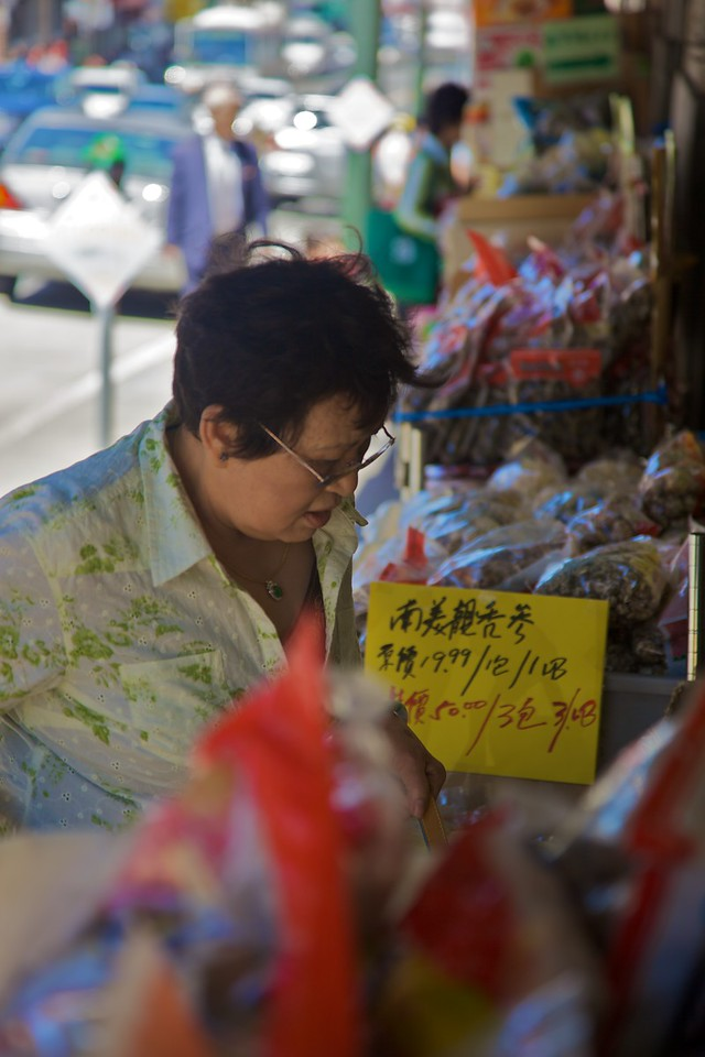 A lady examines the produce at a 'real'Chinese grocery in San Francisco.