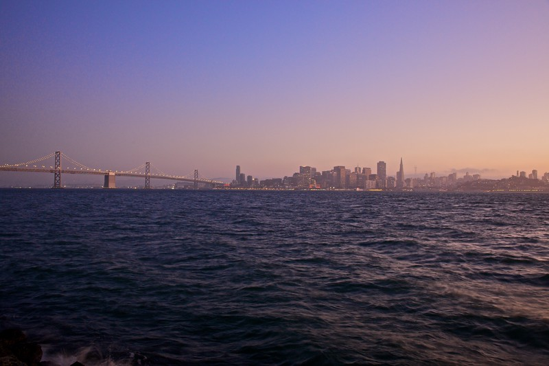 Downtown San Francisco and the Bay Bridge at dusk, as seen from Treasure Island.