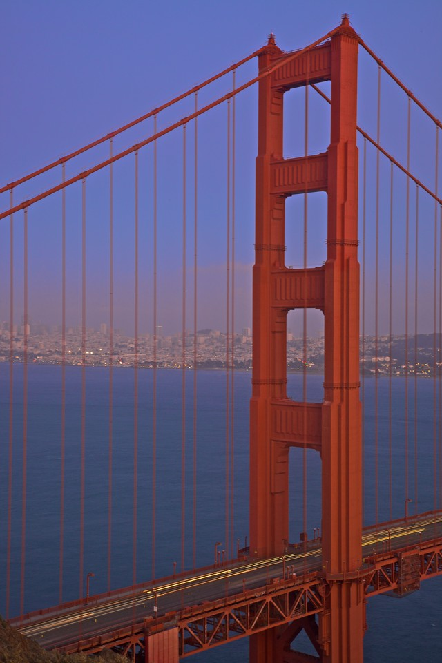 Looking through the Golden Gate Bridge at dusk from the Marin Headlands towards downtown San Francisco.
